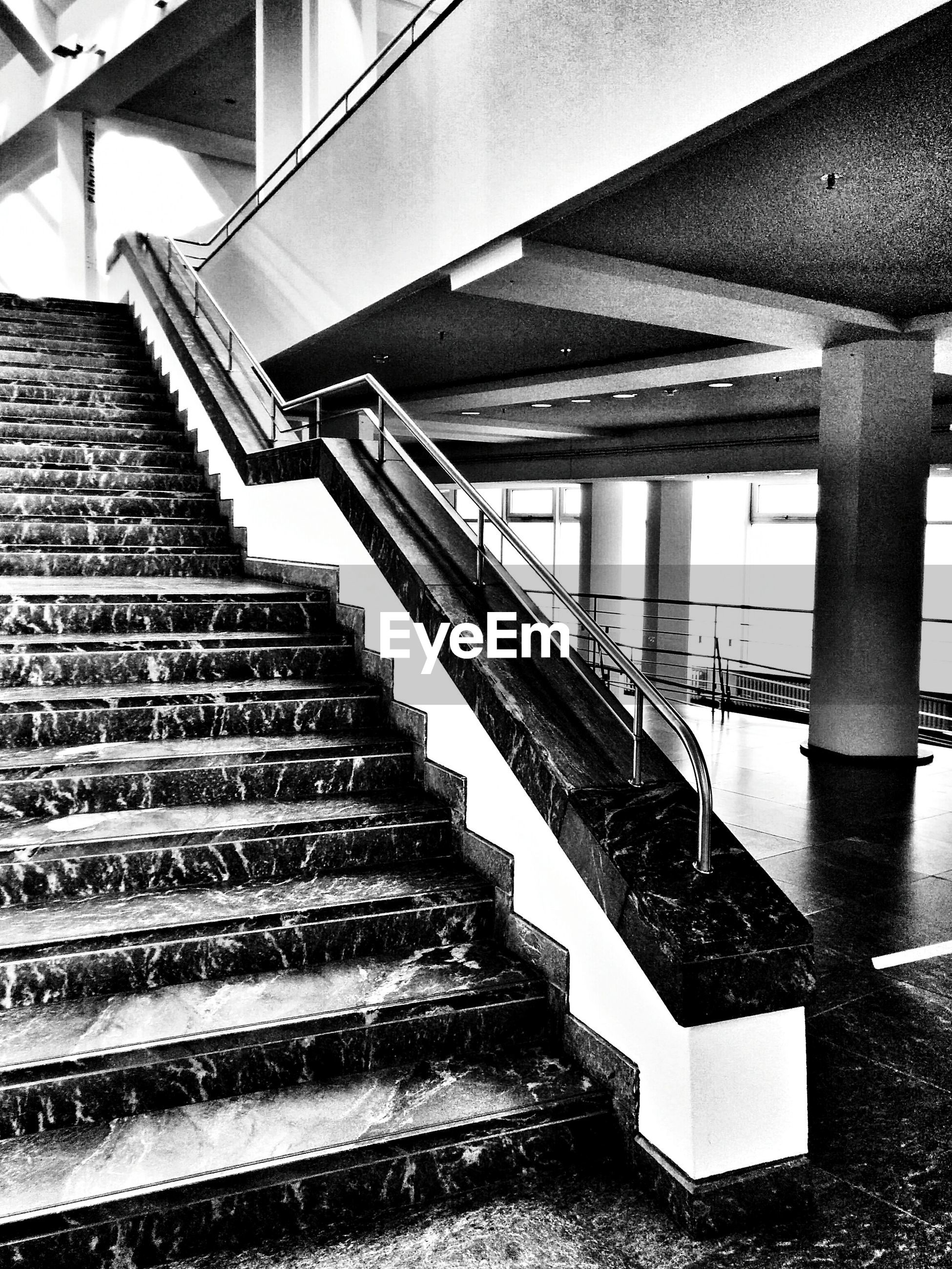 architecture, built structure, steps, staircase, steps and staircases, railing, building exterior, building, low angle view, stairs, pattern, high angle view, indoors, spiral staircase, day, no people, metal, directly below, spiral, modern