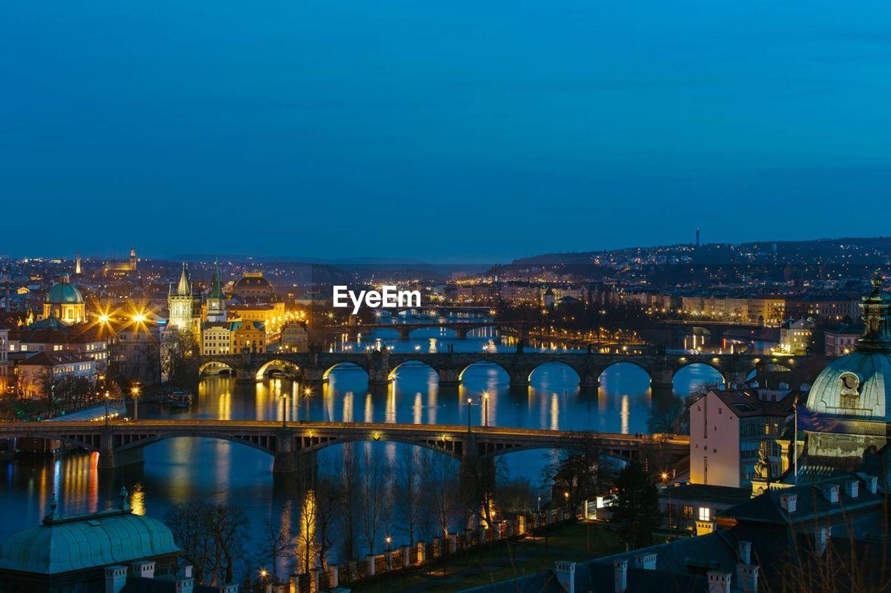 High angle view of illuminated bridges and city