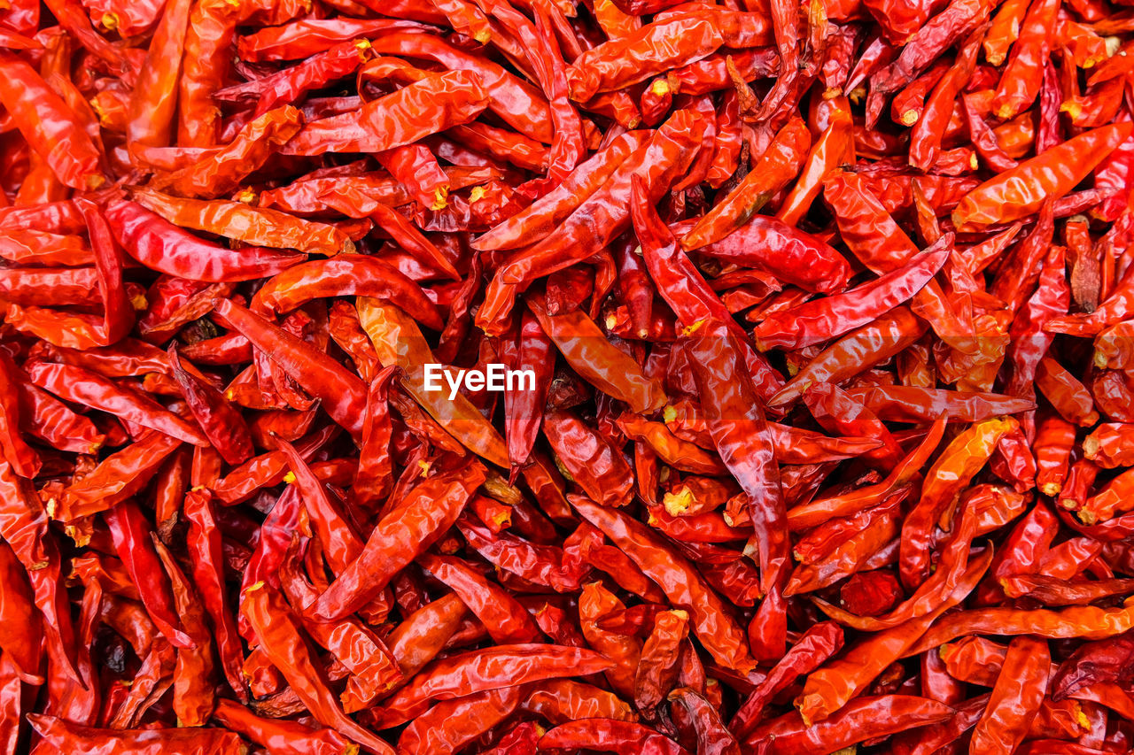 Full Frame Shot Of Red Chili Peppers For Sale At Market