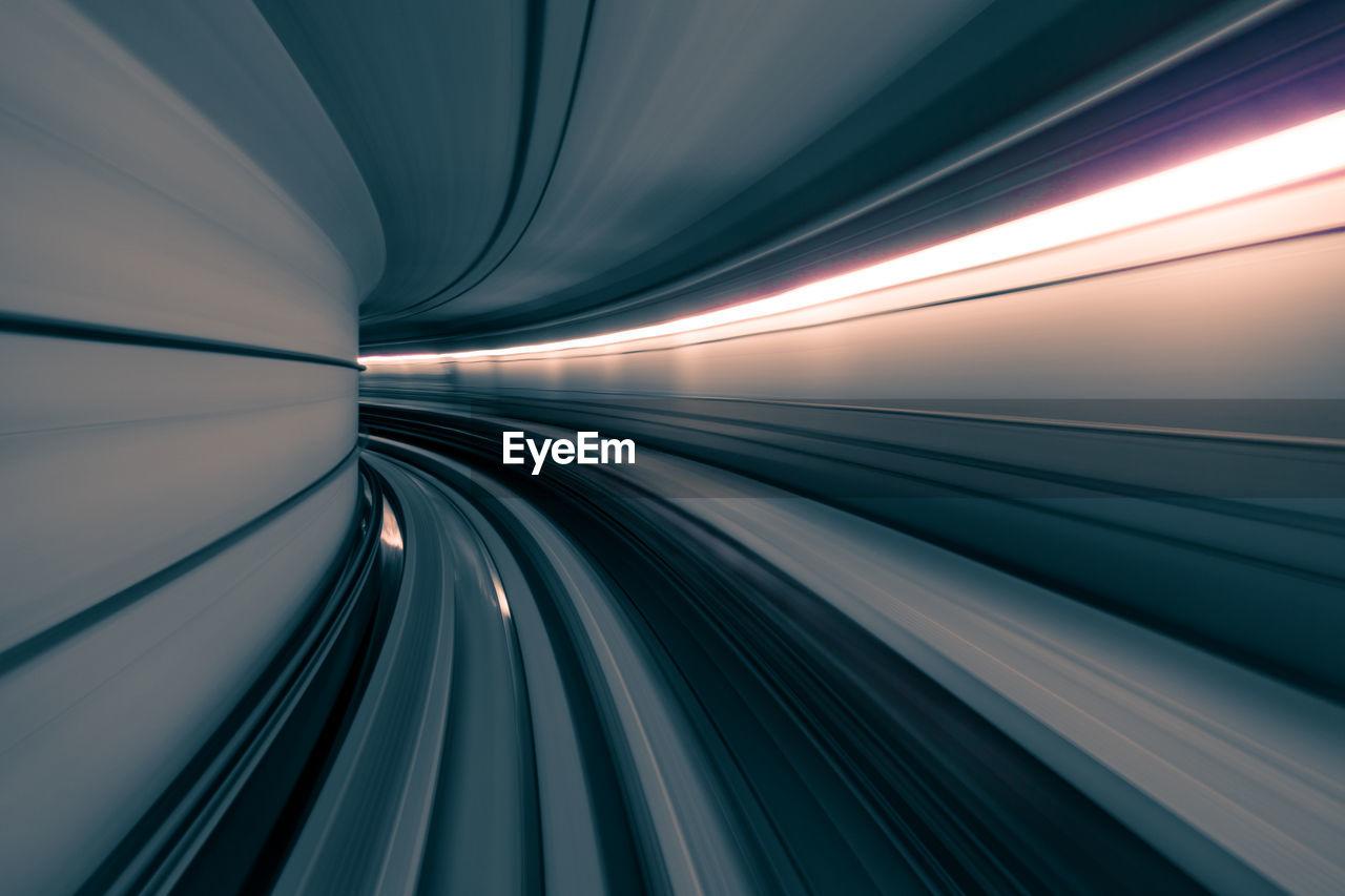 Blurred motion of illuminated tunnel