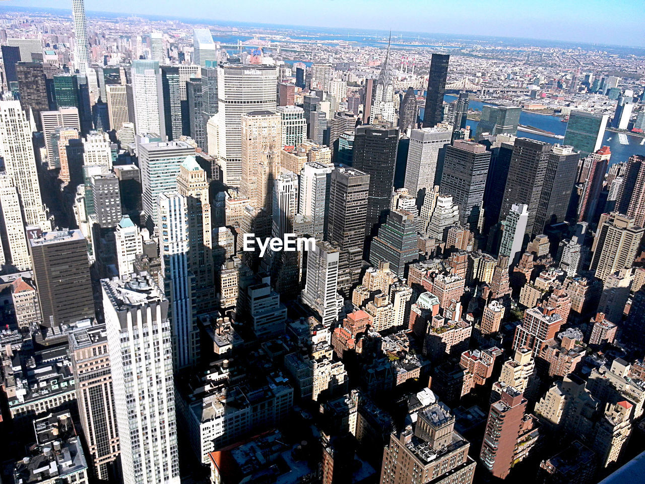 skyscraper, cityscape, architecture, city, aerial view, building exterior, crowded, urban skyline, modern, travel destinations, day, outdoors, built structure, sky, people