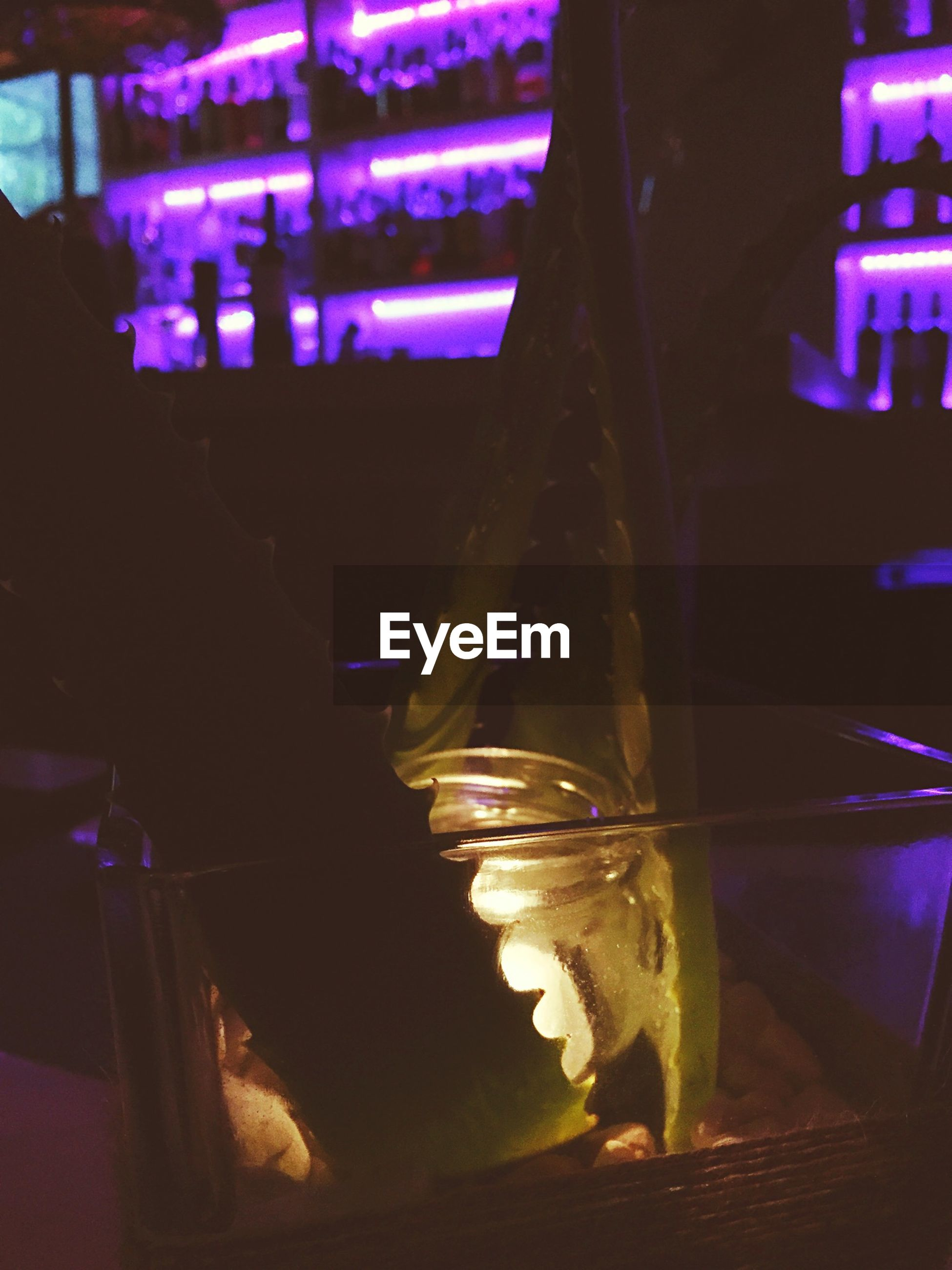 illuminated, night, indoors, focus on foreground, selective focus, close-up, table, lighting equipment, glowing, light - natural phenomenon, reflection, glass - material, no people, dark, still life, candle, lit, restaurant, burning, electric light