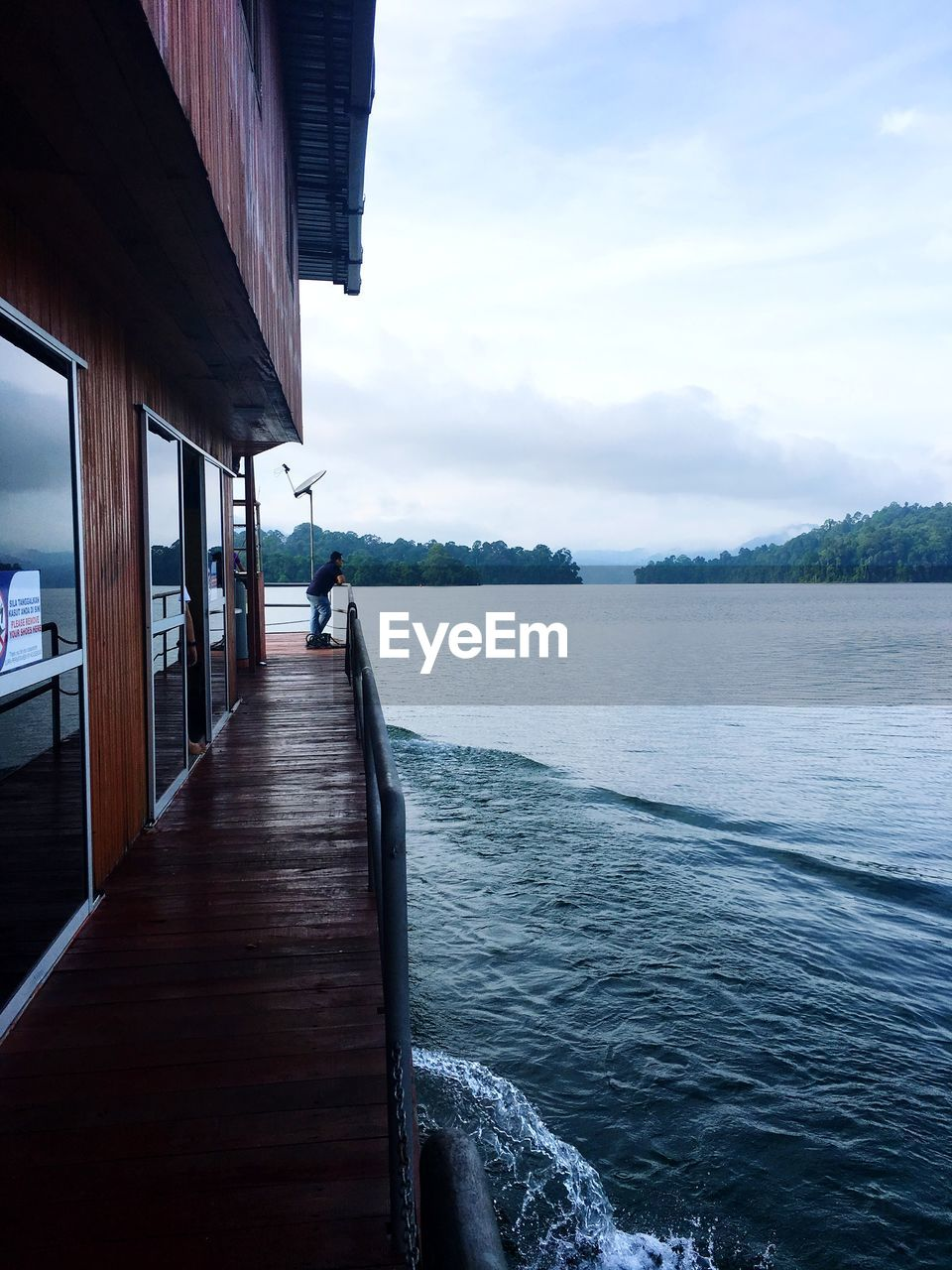 Man admiring view from boat deck
