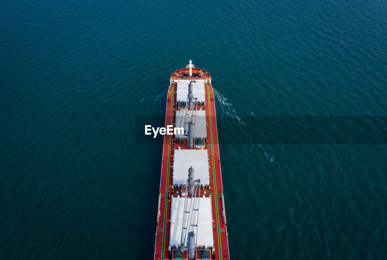 water, sea, high angle view, nature, nautical vessel, no people, day, built structure, architecture, transportation, travel, mode of transportation, blue, outdoors, fuel and power generation, freight transportation, tower, direction, industry, turquoise colored, steel, alloy