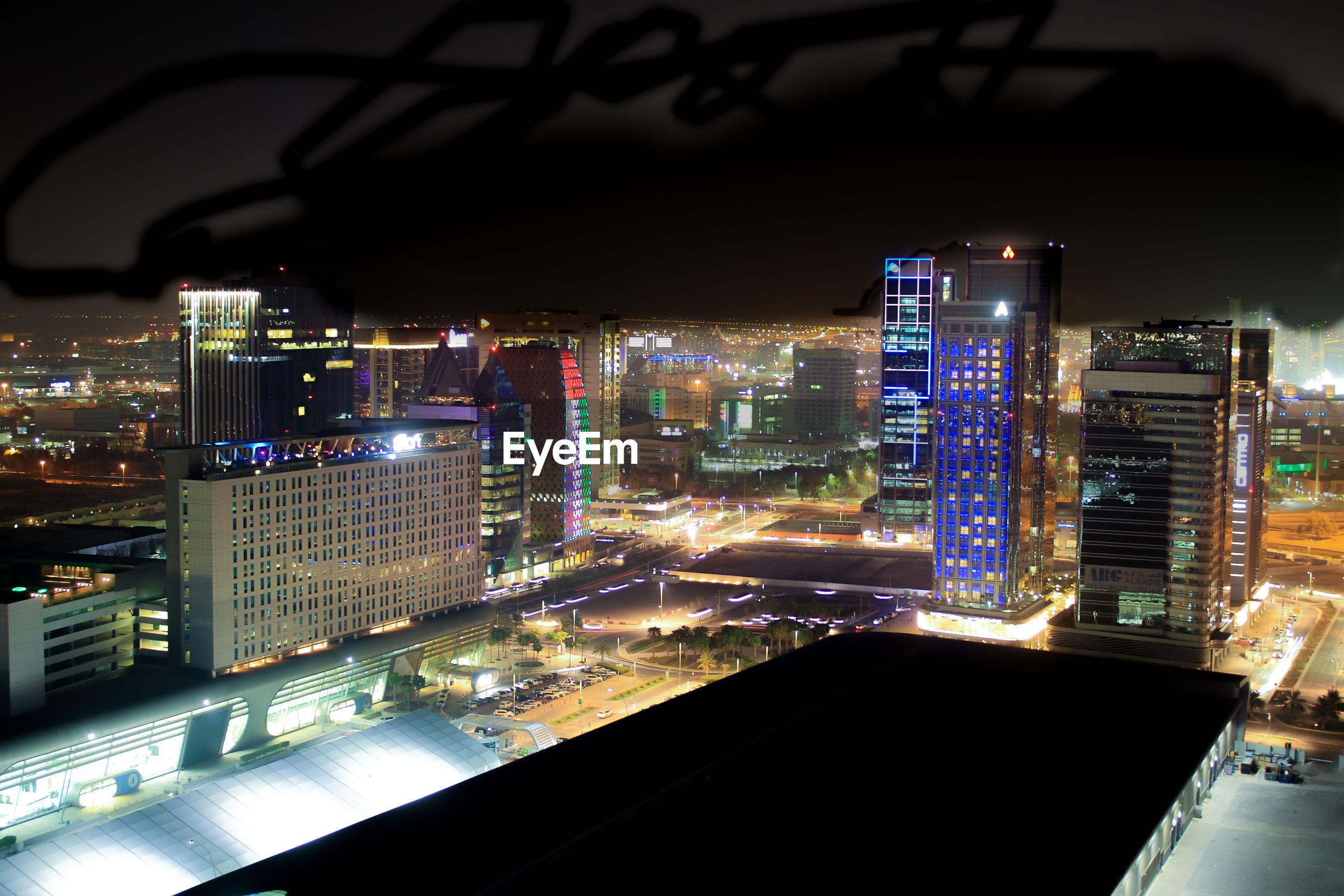 ILLUMINATED MODERN CITYSCAPE SEEN FROM NIGHT AT CITY