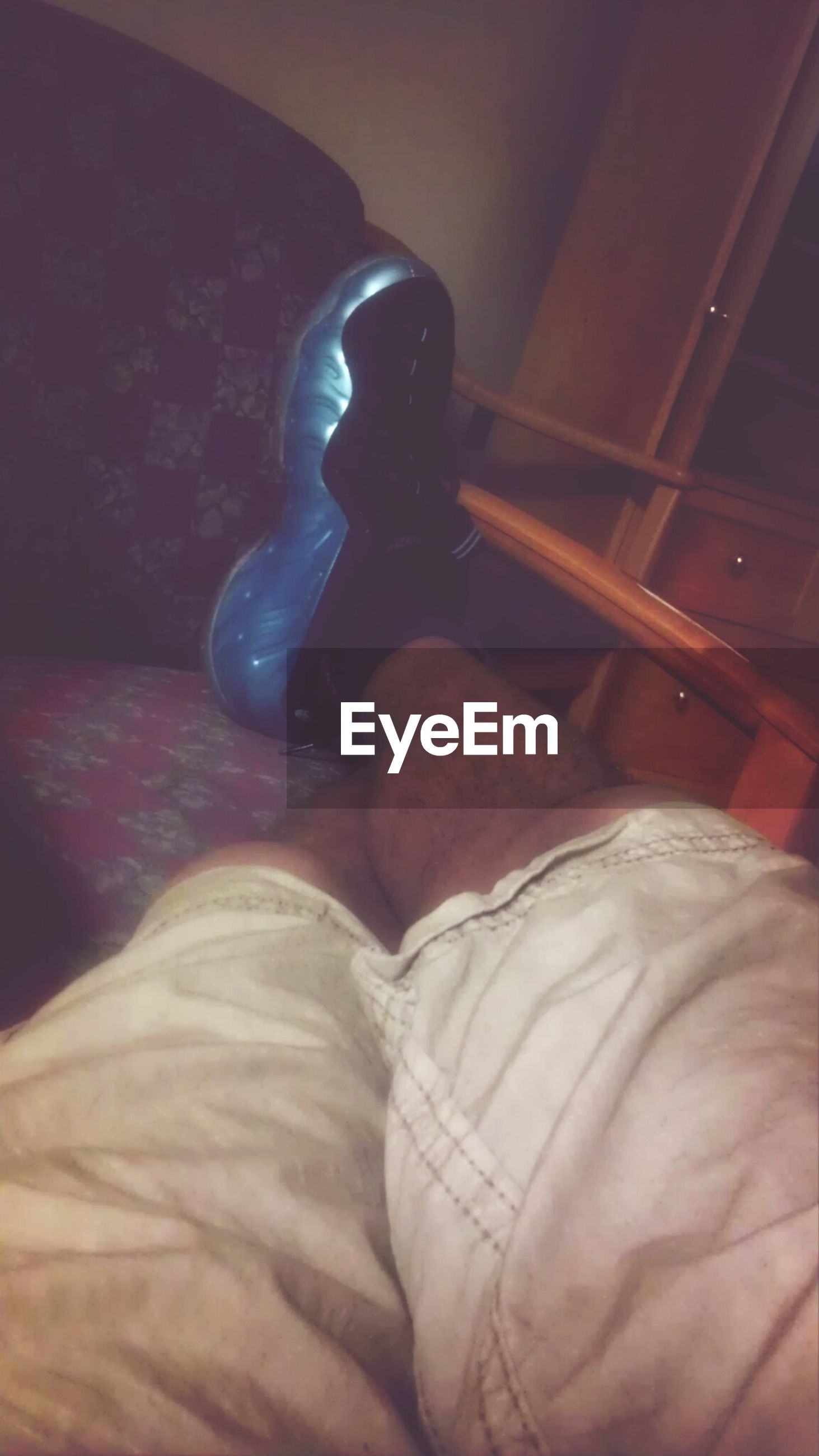indoors, home interior, high angle view, low section, relaxation, sitting, shoe, person, lifestyles, close-up, part of, men, bed, footwear, personal perspective, domestic room, comfortable