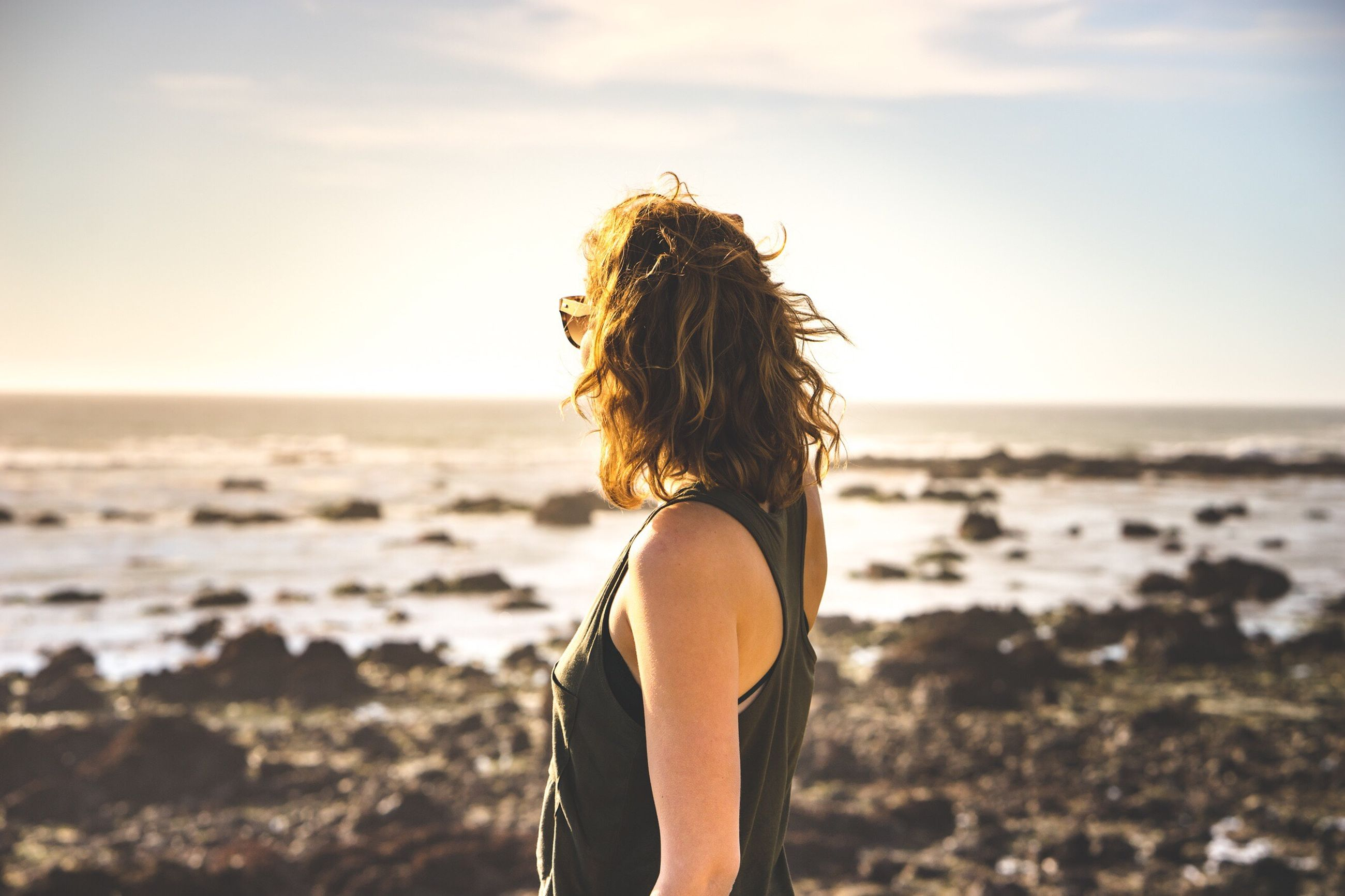 View of woman standing on beach