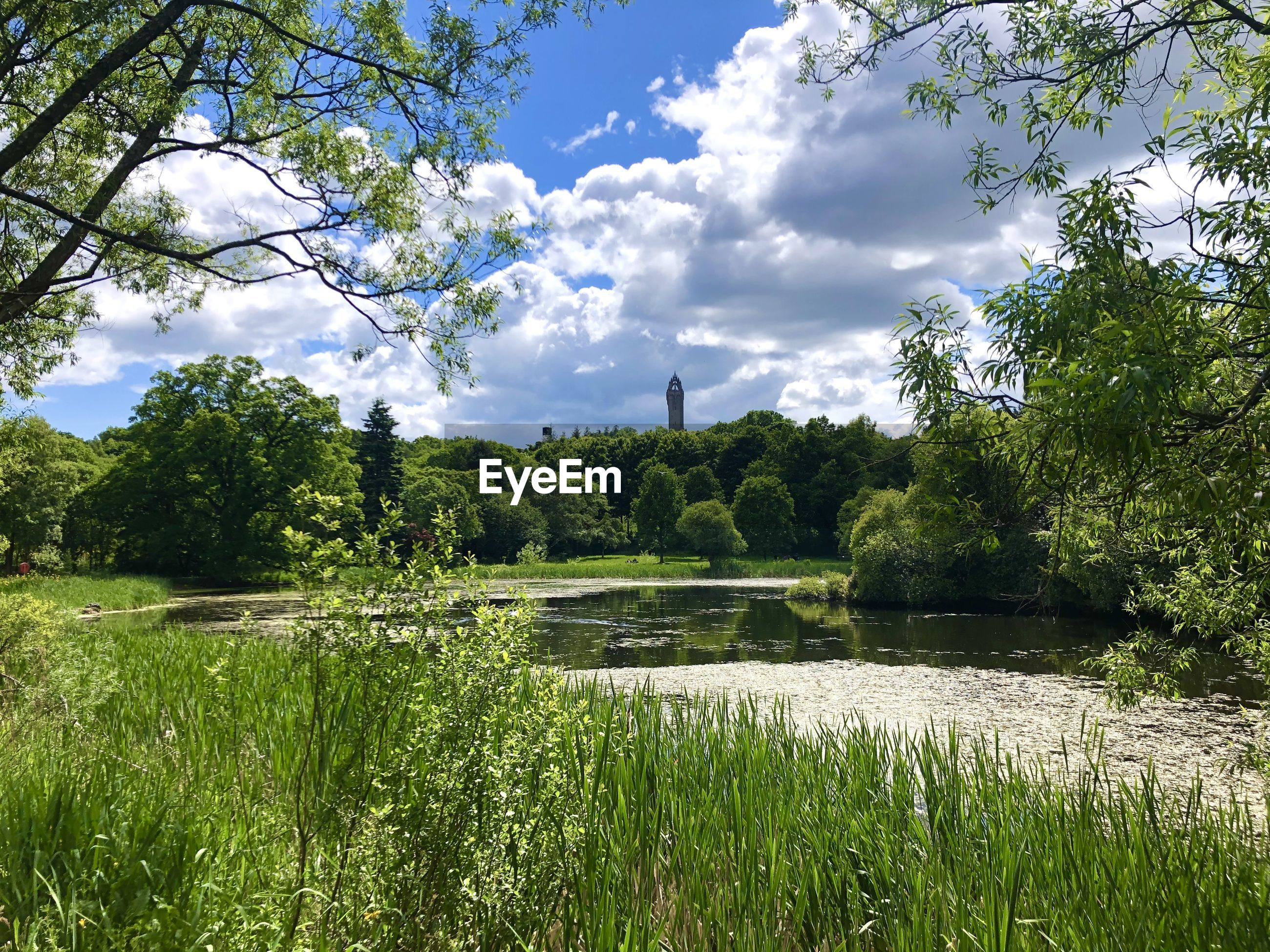 Scenic view of lake against sky with wallace monument