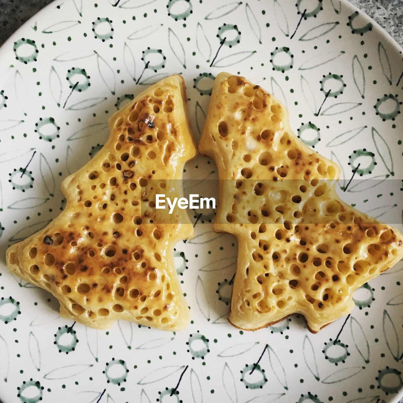 High Angle View Of Christmas Tree Shape Toasted Bread In Plate