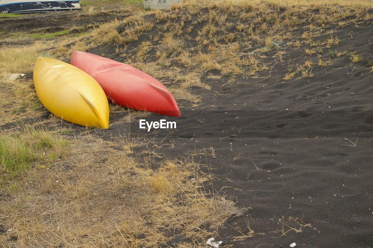 Yellow And Red Kayaks At Beach