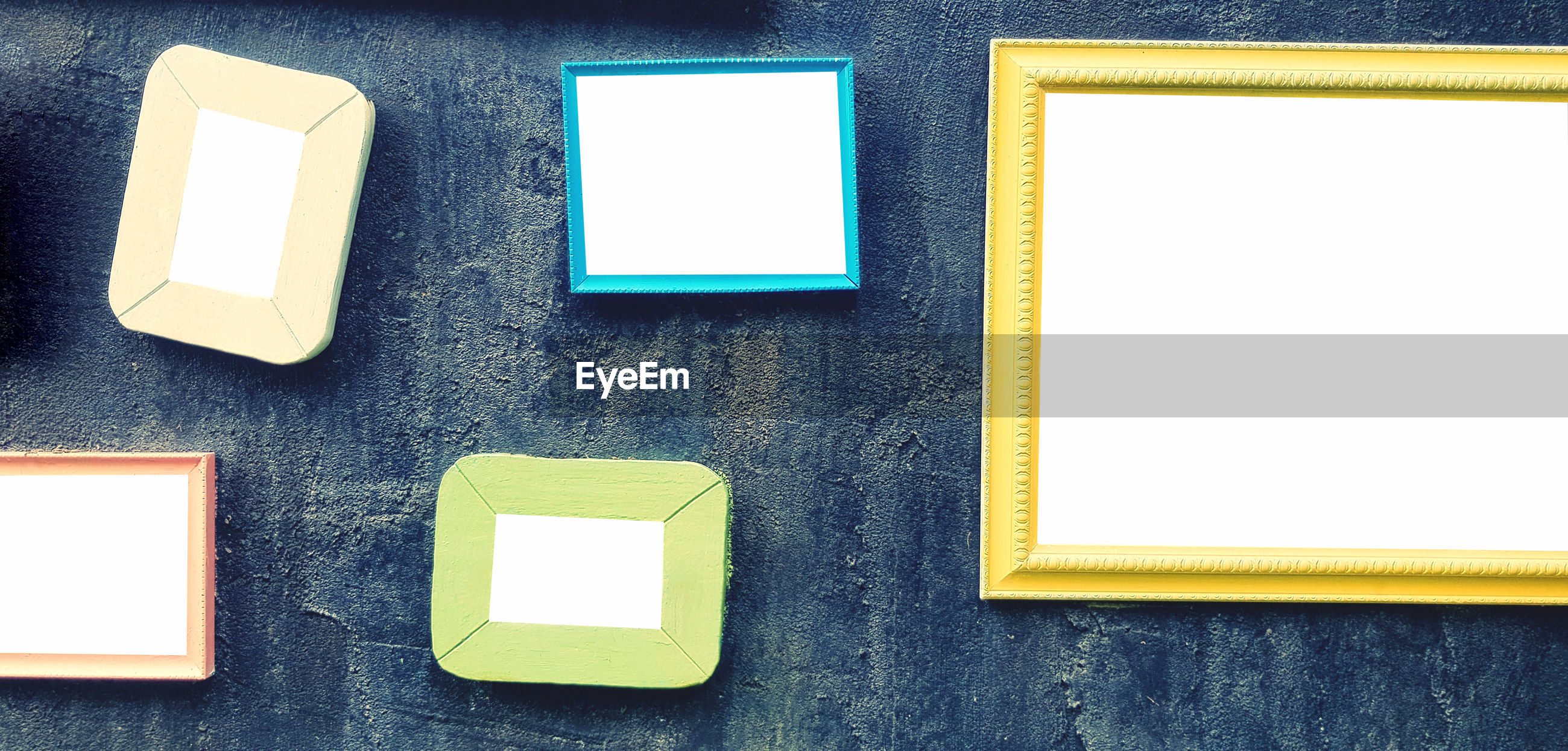 Colorful picture frame on grunge wall background