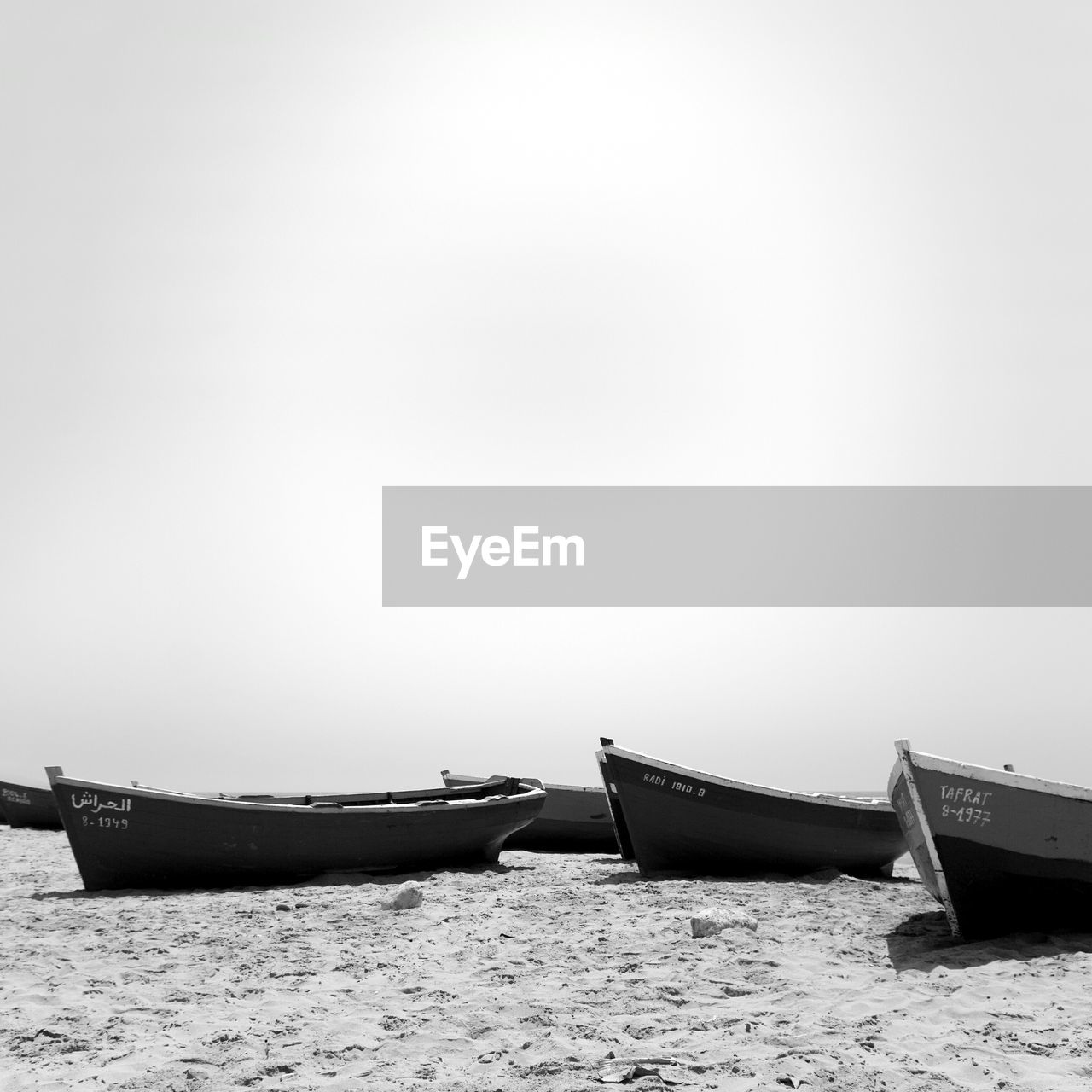 Boats At Beach Against Clear Sky