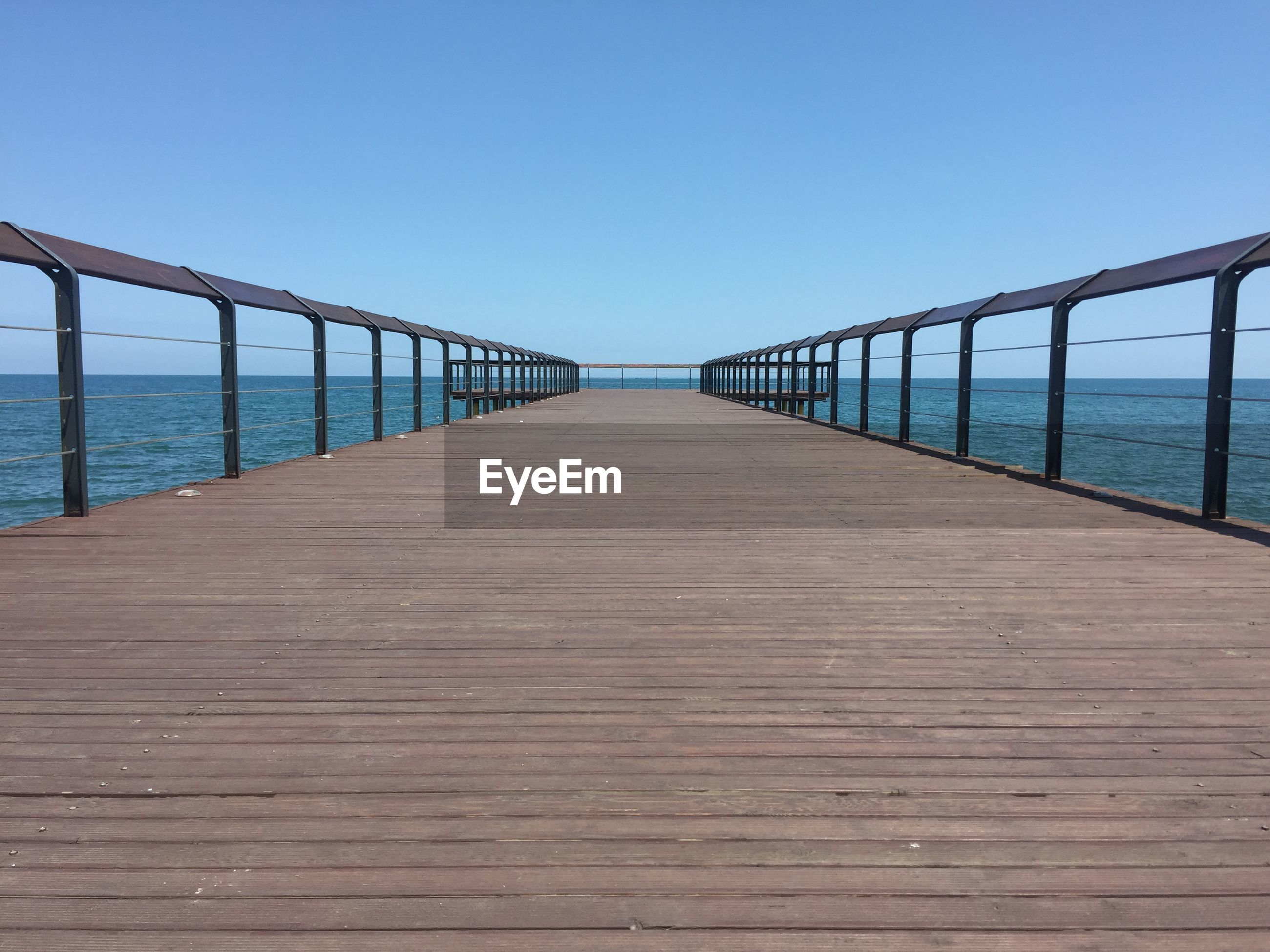 VIEW OF PIER AGAINST CLEAR BLUE SKY