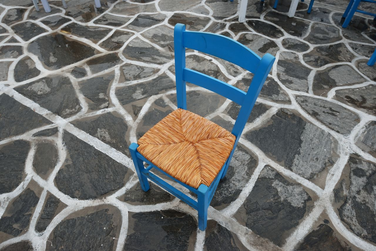 high angle view, no people, absence, flooring, chair, seat, pattern, day, footpath, empty, blue, outdoors, nature, tile, land, plastic, protection, architecture, metal, wet