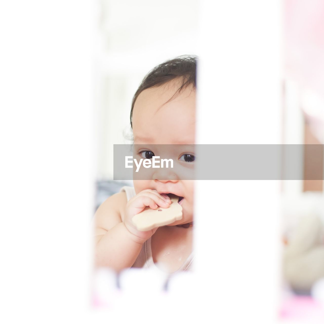 baby, childhood, real people, innocence, one person, indoors, babyhood, cute, home interior, toddler, looking at camera, lifestyles, close-up, portrait, human hand, day