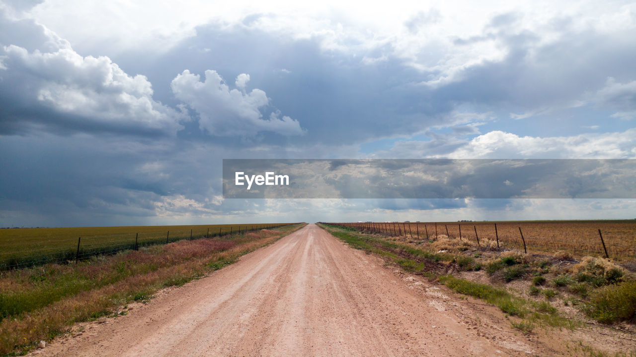 cloud - sky, sky, landscape, direction, road, environment, the way forward, land, tranquil scene, scenics - nature, field, tranquility, diminishing perspective, beauty in nature, transportation, nature, dirt, no people, vanishing point, dirt road, outdoors, long