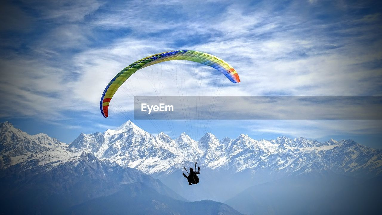 Tourists Flying Over Mountain