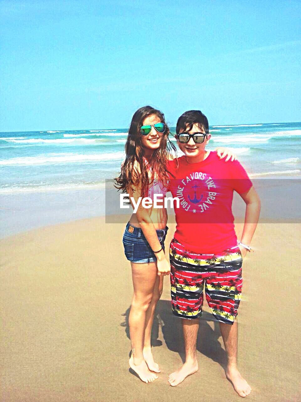 beach, sea, sunglasses, vacations, summer, sand, standing, young adult, two people, young women, full length, looking at camera, portrait, fun, leisure activity, beauty in nature, outdoors, togetherness, nature, lifestyles, friendship, real people, scenics, day, happiness, water, adult, beautiful woman, sky, women, smiling, horizon over water, eyeglasses, only women, people, adults only