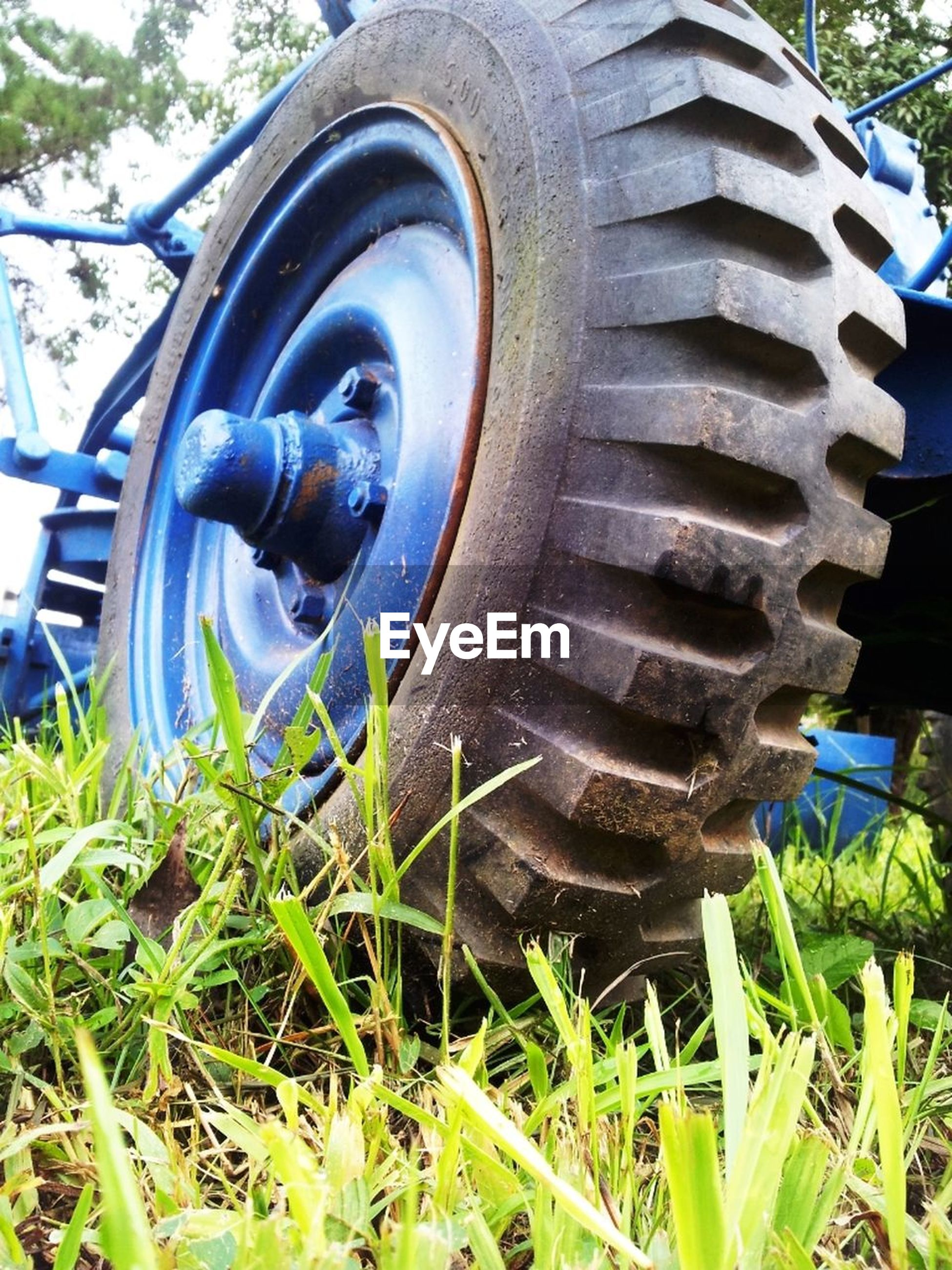 tire, metal, wheel, field, grass, day, outdoors, no people, close-up, land vehicle, vehicle part, nature
