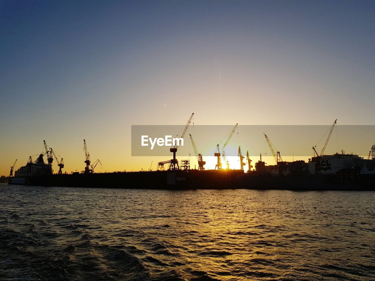 sunset, water, silhouette, clear sky, no people, transportation, nautical vessel, nature, crane - construction machinery, sea, waterfront, freight transportation, tranquility, sky, outdoors, commercial dock, harbor, beauty in nature, day