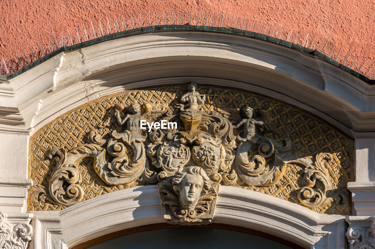 architecture, built structure, building exterior, low angle view, art and craft, no people, building, carving - craft product, craft, sculpture, day, representation, design, pattern, wall - building feature, ornate, creativity, the past, arch, outdoors, bas relief