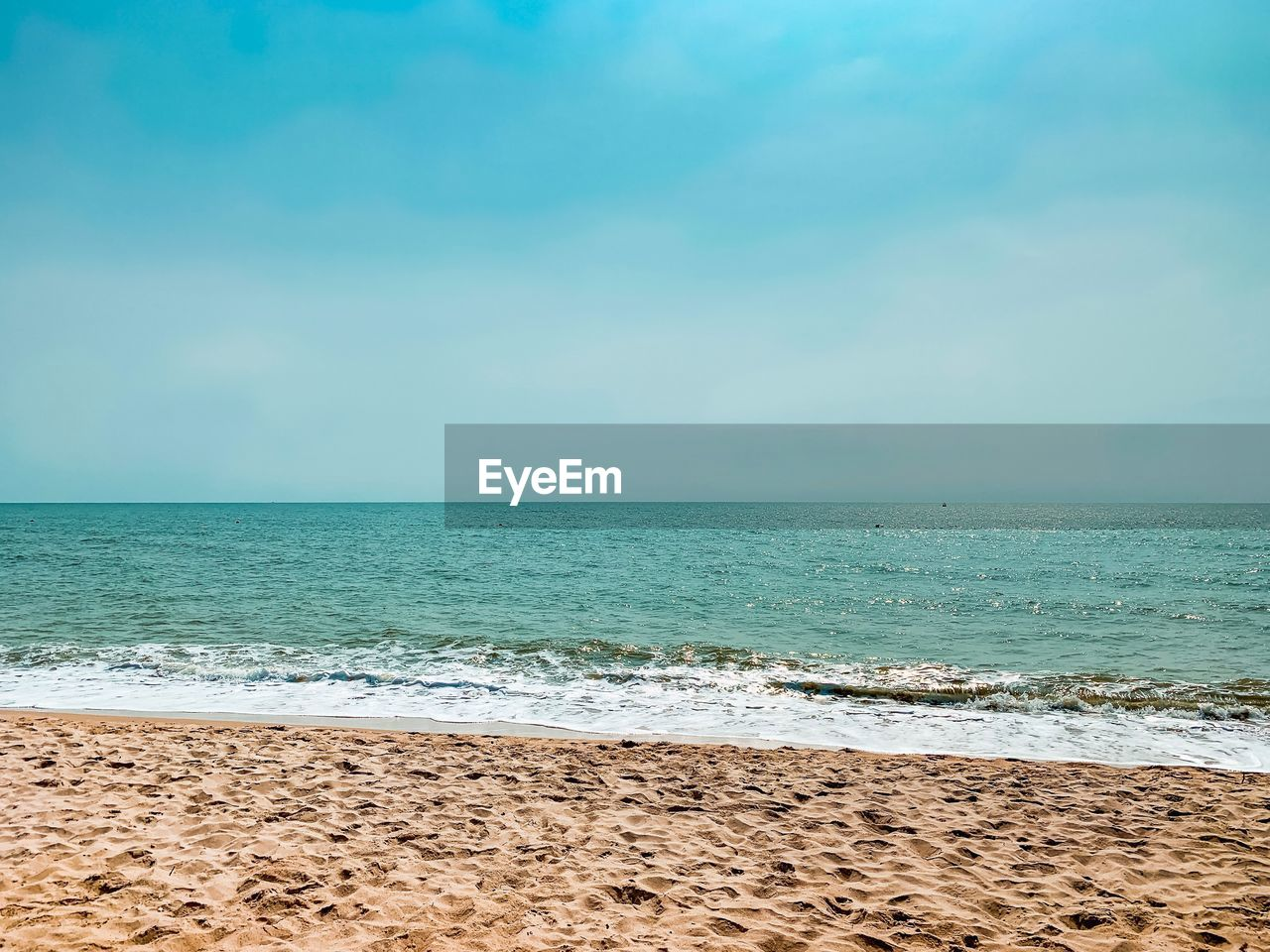 sea, water, horizon, beach, beauty in nature, land, sky, horizon over water, scenics - nature, tranquility, tranquil scene, sand, idyllic, blue, no people, nature, motion, wave, day, outdoors, turquoise colored