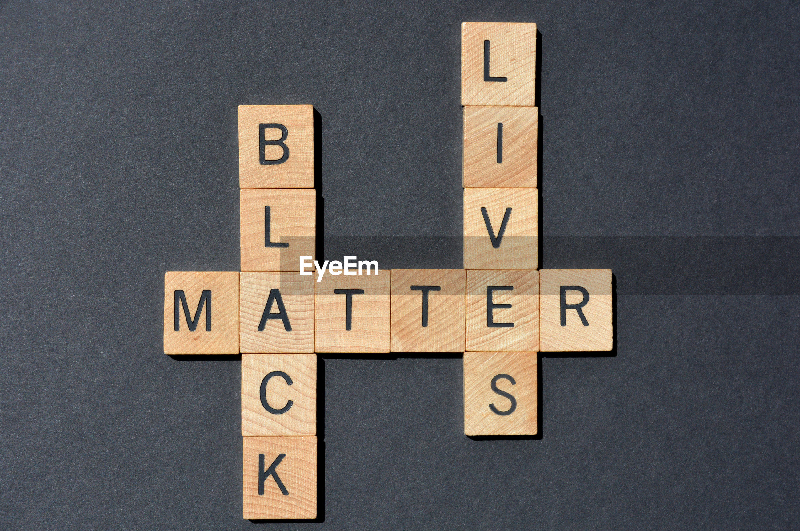 Black lives matter, words in 3d wooden alphabet letters in crossword form on black background