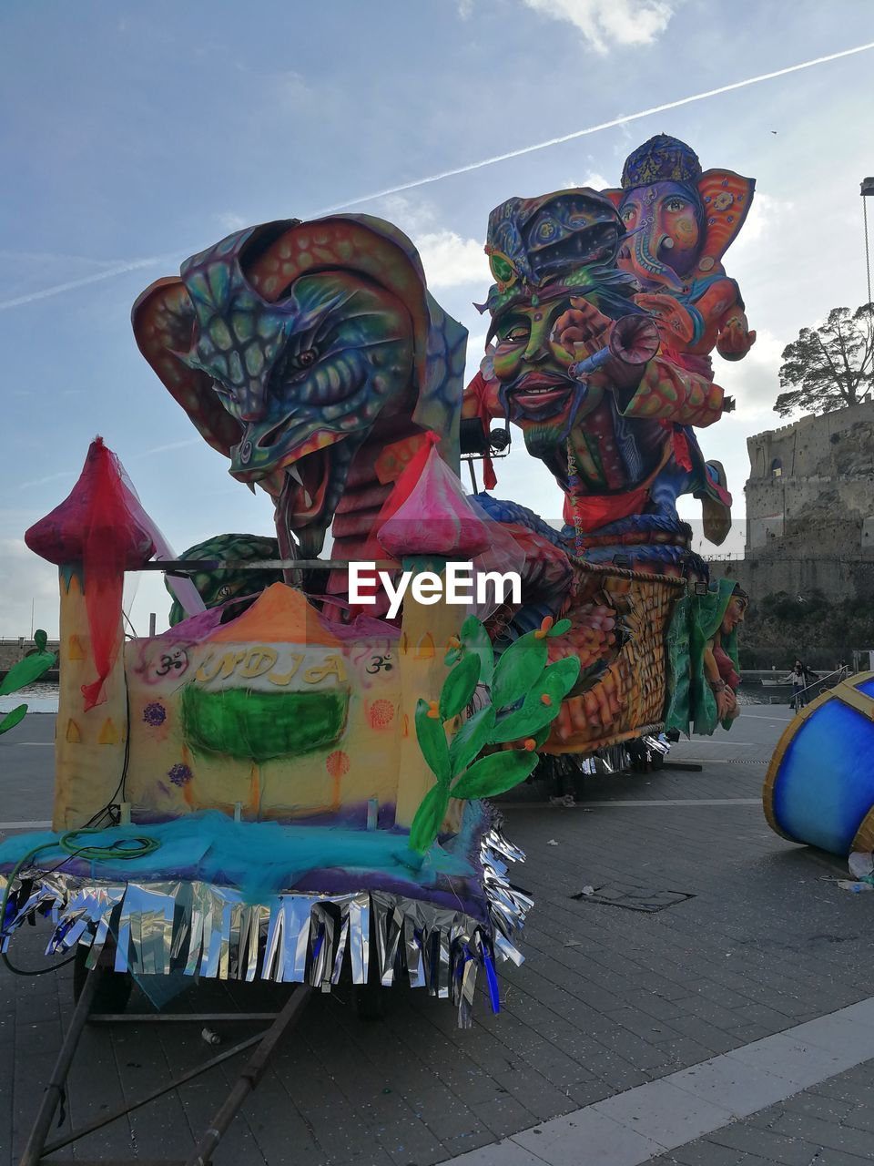 multi colored, art and craft, creativity, sky, representation, sculpture, day, no people, human representation, statue, craft, nature, cloud - sky, outdoors, belief, decoration, architecture, arts culture and entertainment, festival
