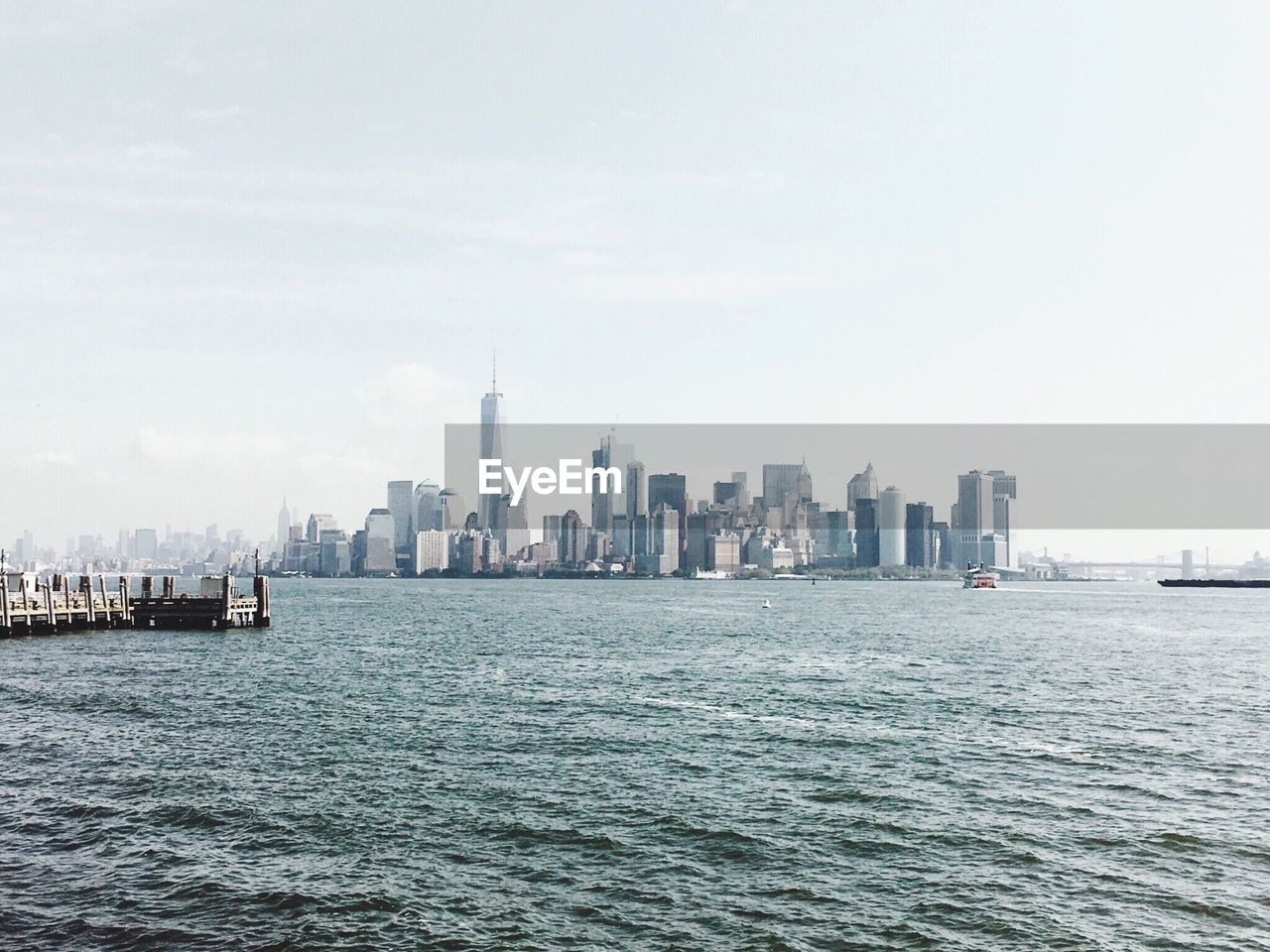 skyscraper, city, cityscape, architecture, building exterior, modern, urban skyline, downtown district, built structure, tower, waterfront, skyline, sky, water, day, sea, outdoors, no people