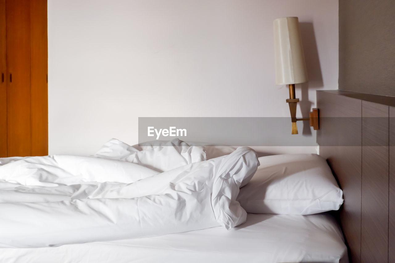 White bed in bedroom