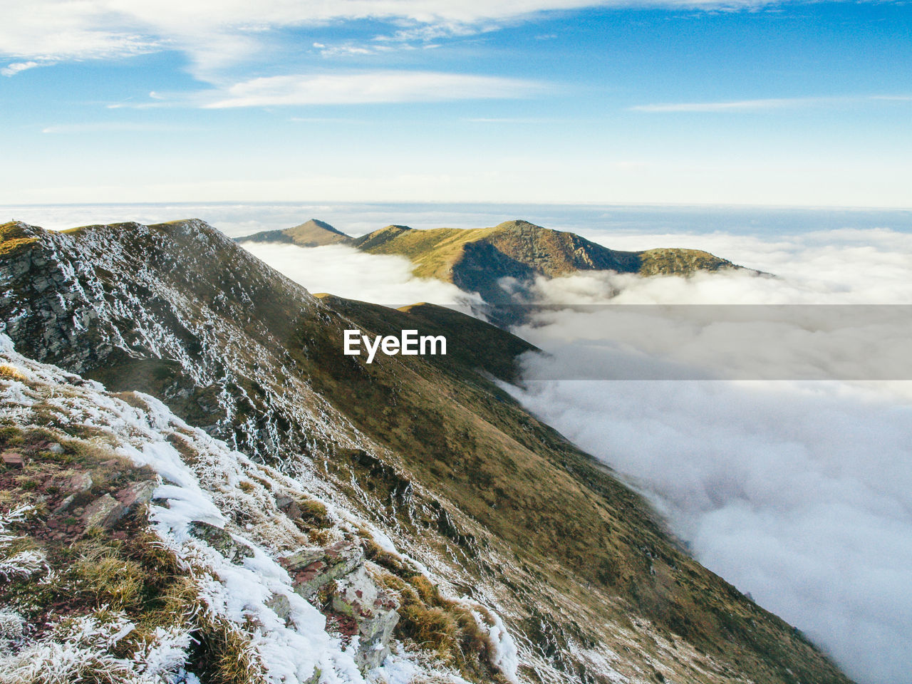 Scenic View Of Mountains And Cloudscape During Winter