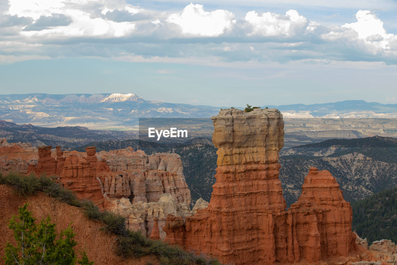 cloud - sky, sky, rock formation, rock, mountain, rock - object, scenics - nature, beauty in nature, solid, landscape, tranquil scene, travel, nature, tranquility, environment, non-urban scene, travel destinations, canyon, geology, no people, mountain range, outdoors, eroded, formation, arid climate