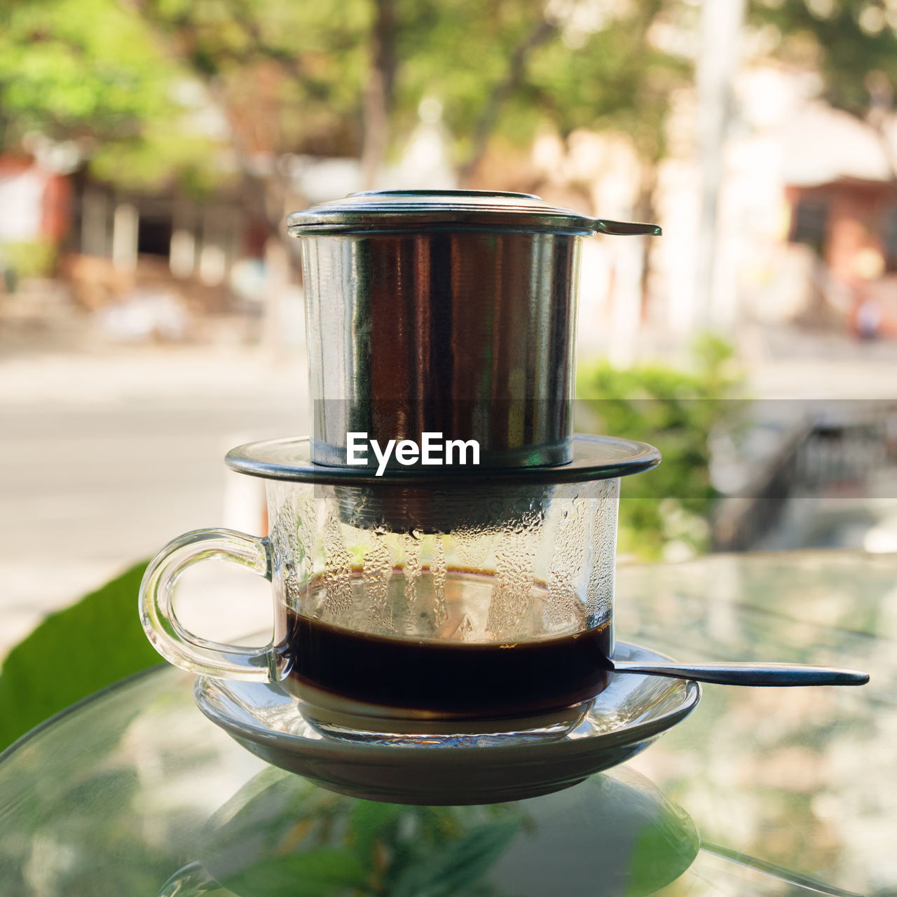 food and drink, drink, refreshment, focus on foreground, close-up, coffee, day, table, cup, coffee - drink, mug, household equipment, freshness, hot drink, glass, tea, kitchen utensil, drinking glass, still life, coffee cup, no people, outdoors, crockery, tea cup, steel