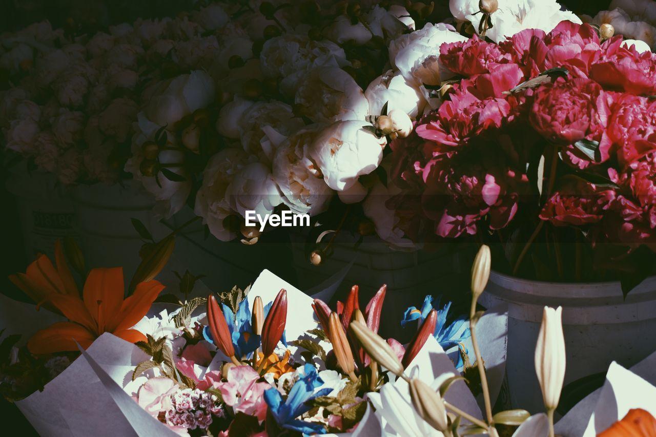 flower, petal, freshness, bouquet, fragility, beauty in nature, nature, flower head, flower arrangement, flower shop, no people, rose - flower, variation, vase, day, flower market, outdoors, gift, close-up, florist
