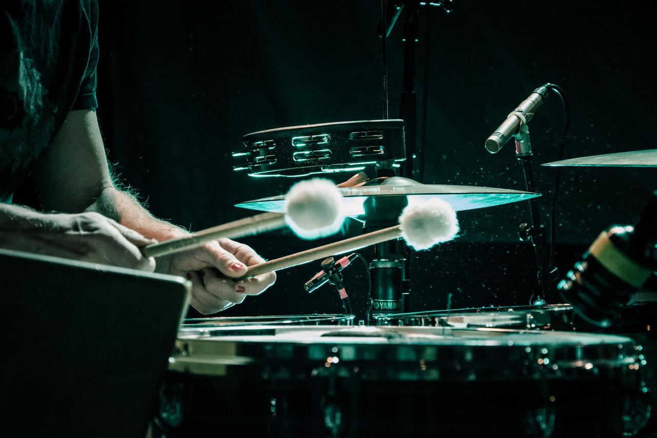 Cropped Image Of Man Playing Drum Kit