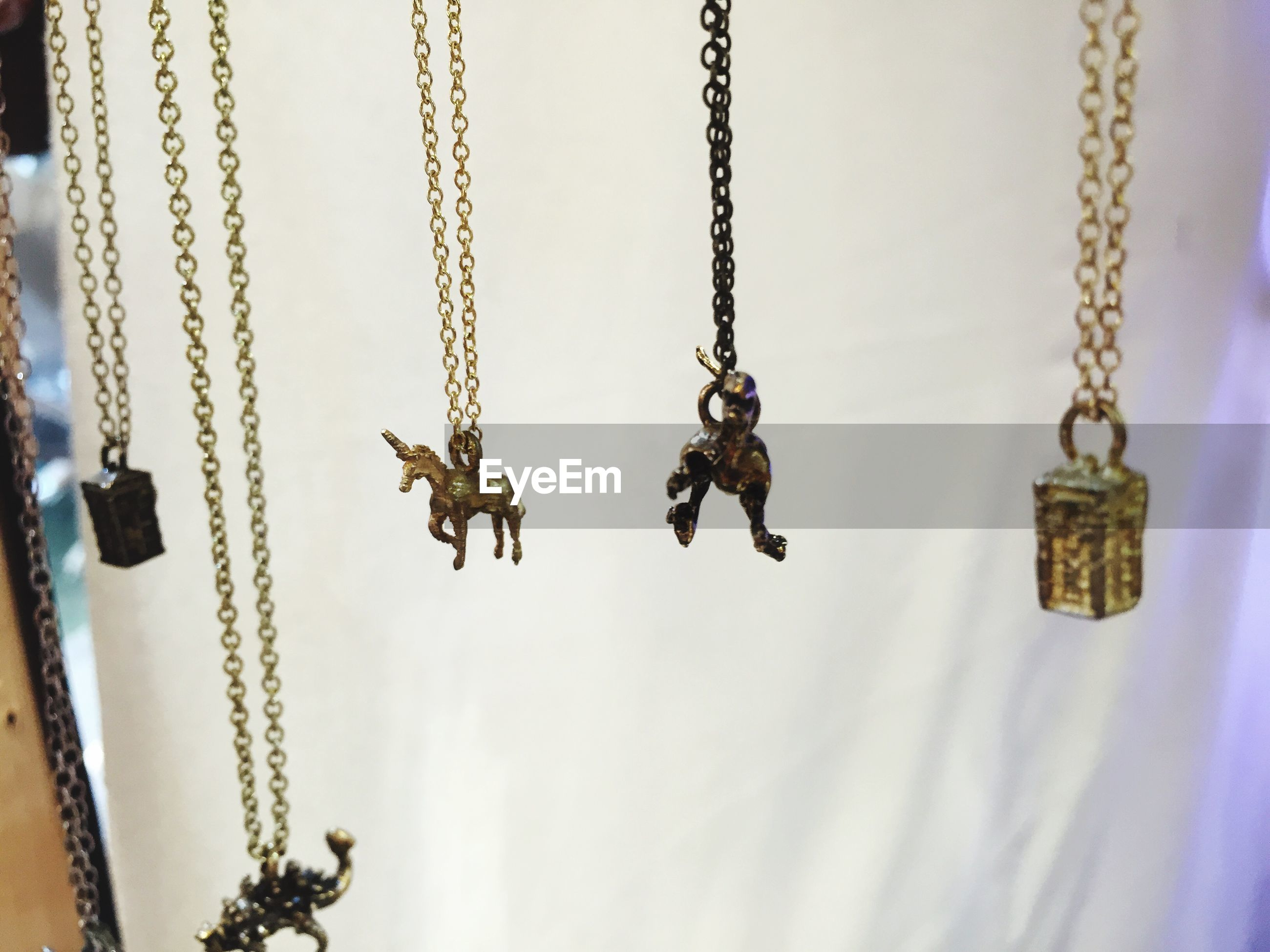 Close-up of various necklaces