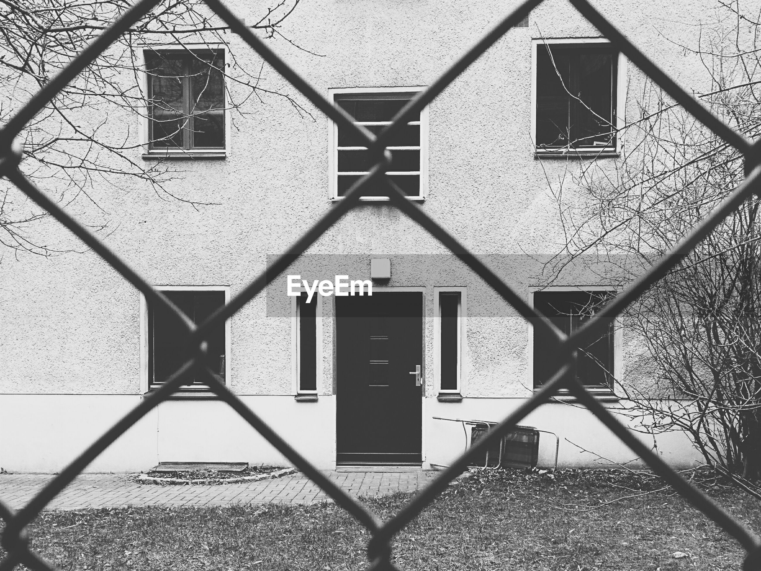 Building seen through chainlink fence