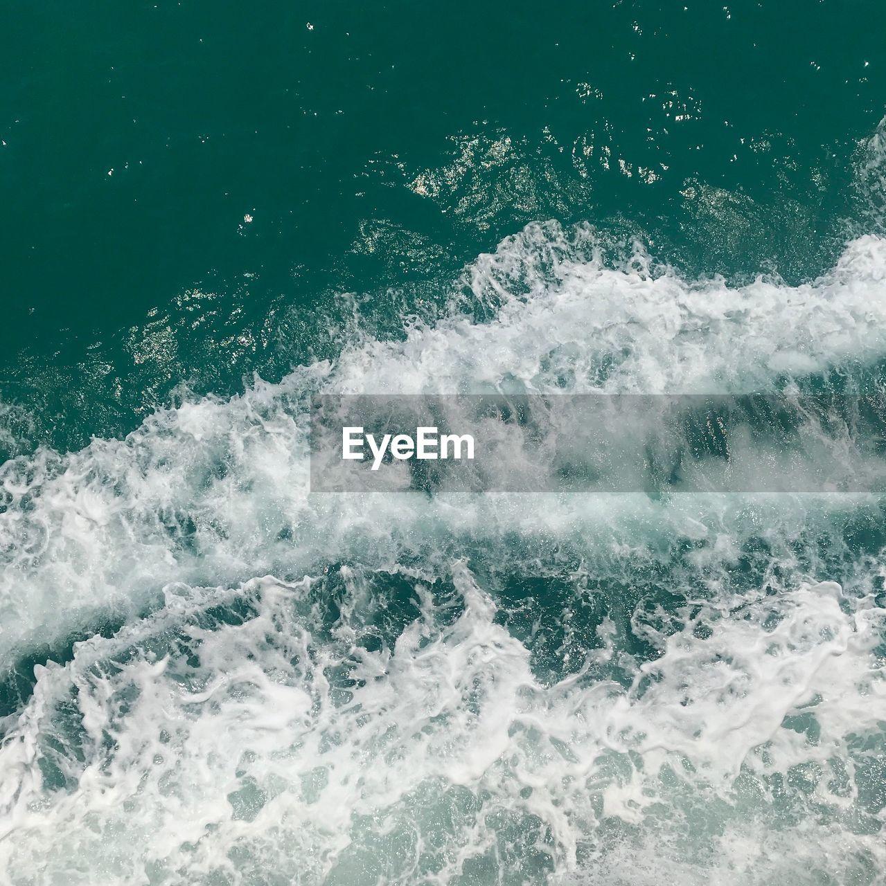 WAVES SPLASHING ON SEA