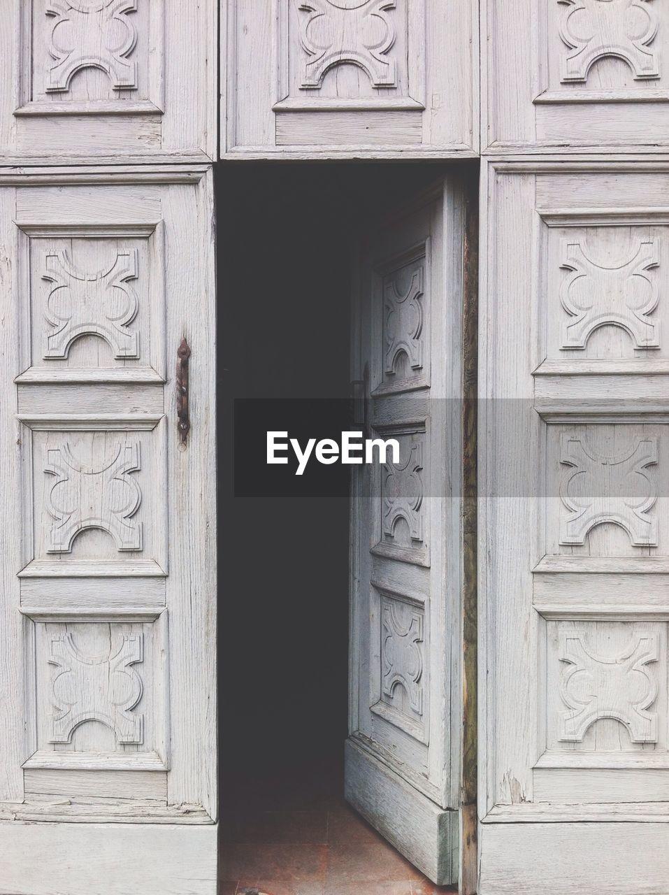 White Open Door Of House