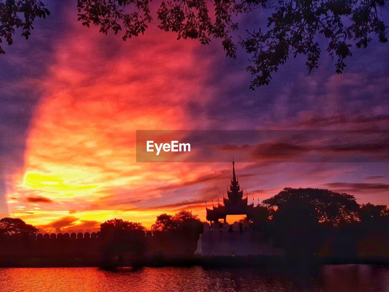 sunset, sky, cloud - sky, architecture, built structure, water, tree, building exterior, nature, orange color, silhouette, plant, no people, building, beauty in nature, waterfront, belief, religion, place of worship, outdoors, spire, romantic sky