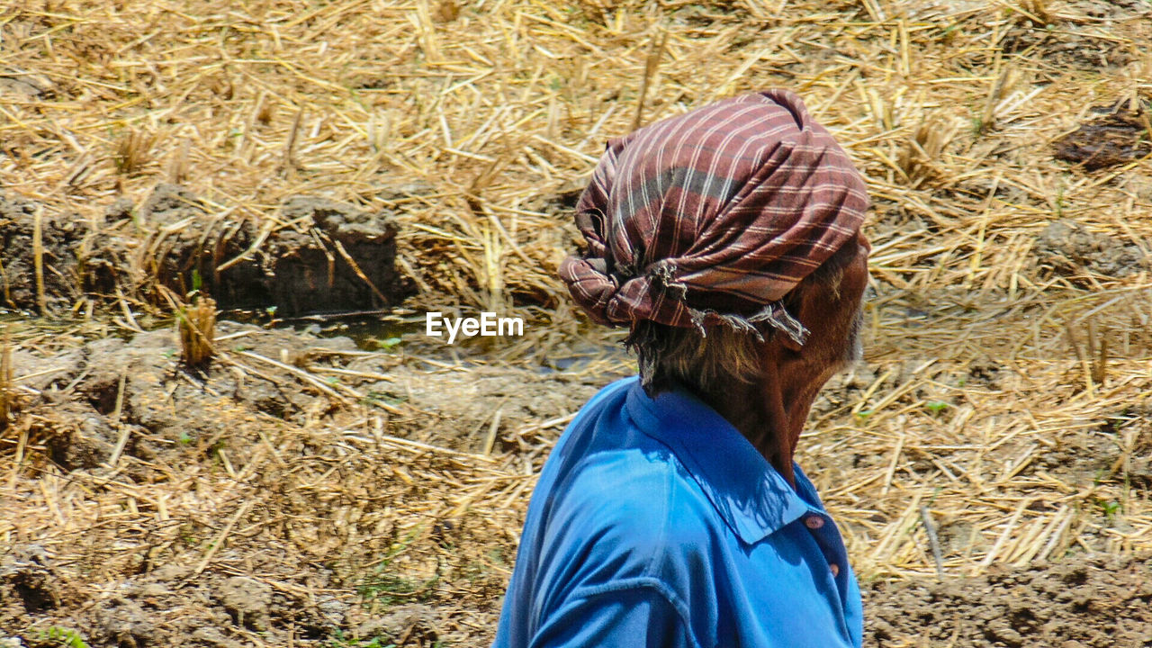 High Angle View Of Farmer On Field
