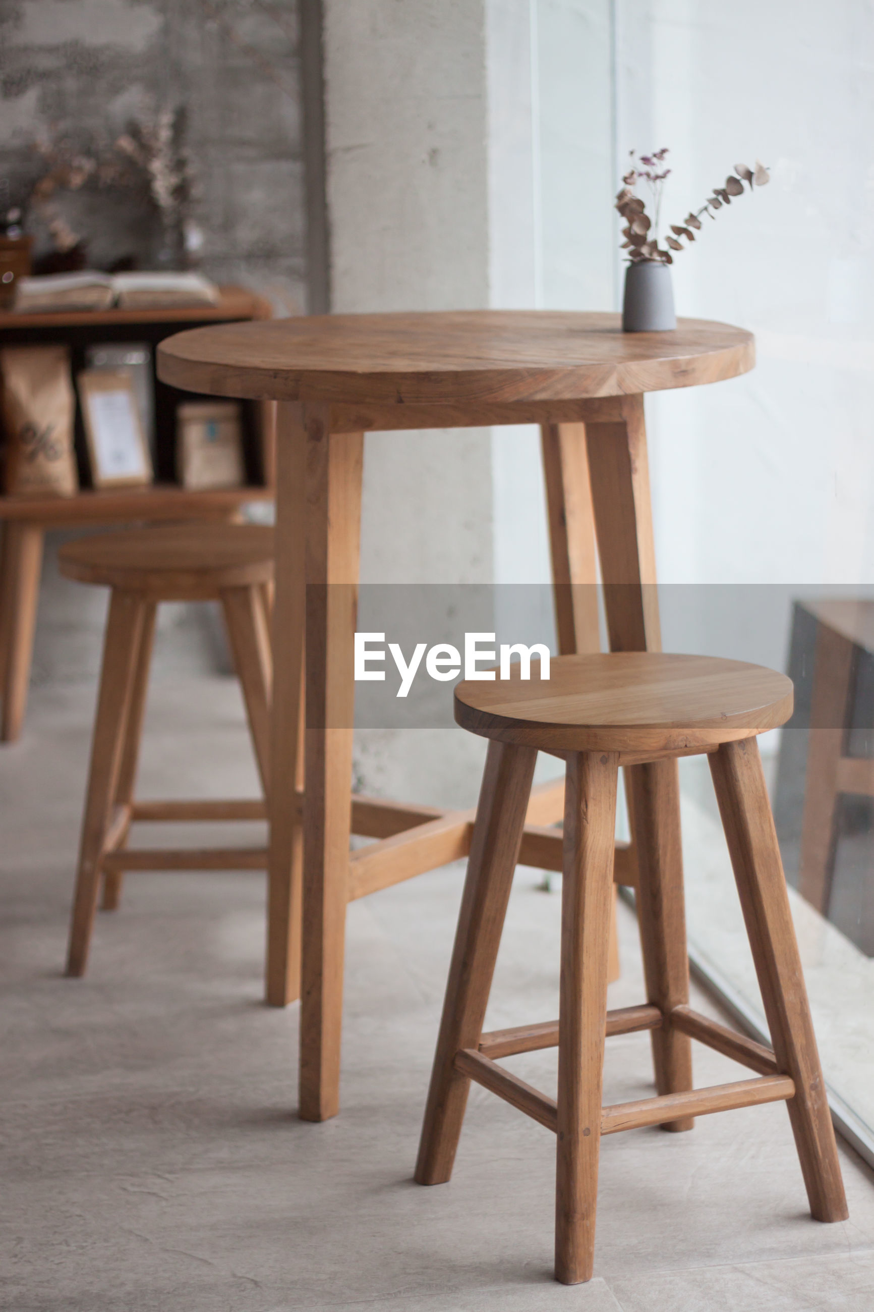 Empty stools and table at cafe