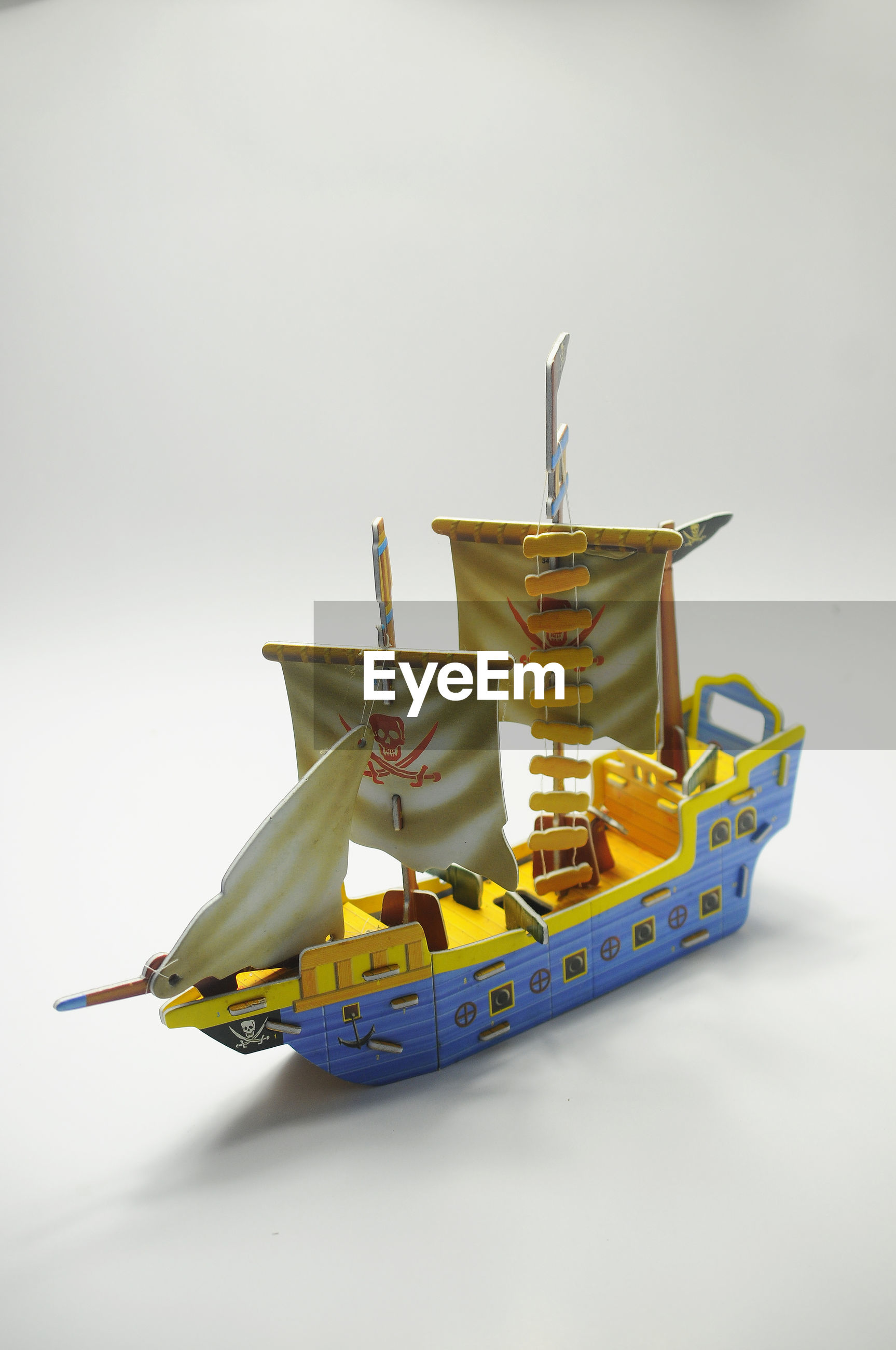 Close-up of paper pirates toy against white background