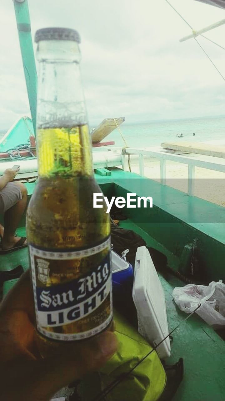bottle, text, drink, food and drink, water, no people, day, green color, close-up, sea, table, freshness, outdoors, food, healthy eating, nature, sky