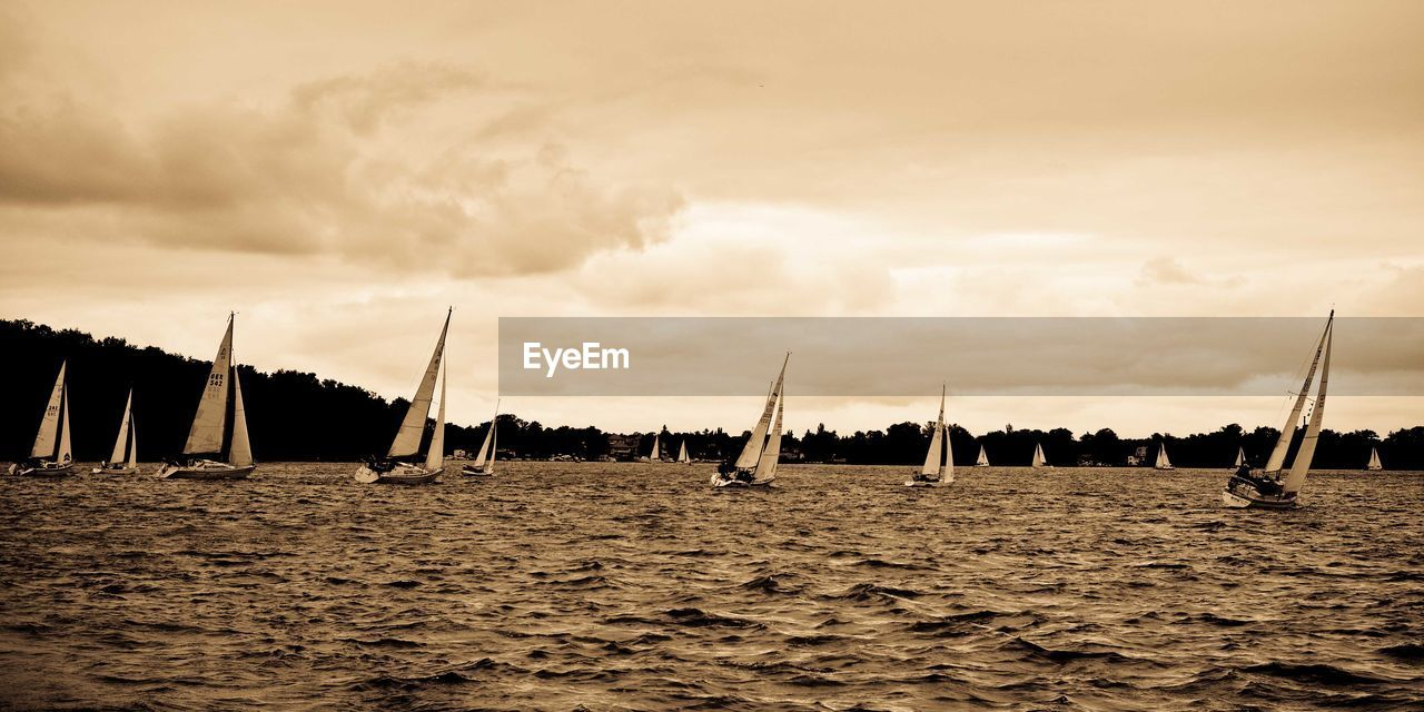 sky, nautical vessel, sailboat, transportation, sea, outdoors, cloud - sky, mast, tranquility, nature, day, water, sailing, no people