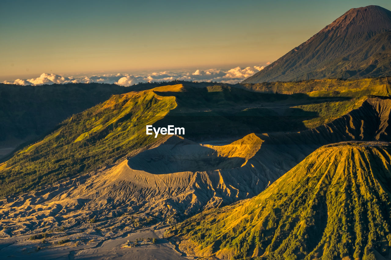 Aerial view of snowcapped mountain against sky during sunset