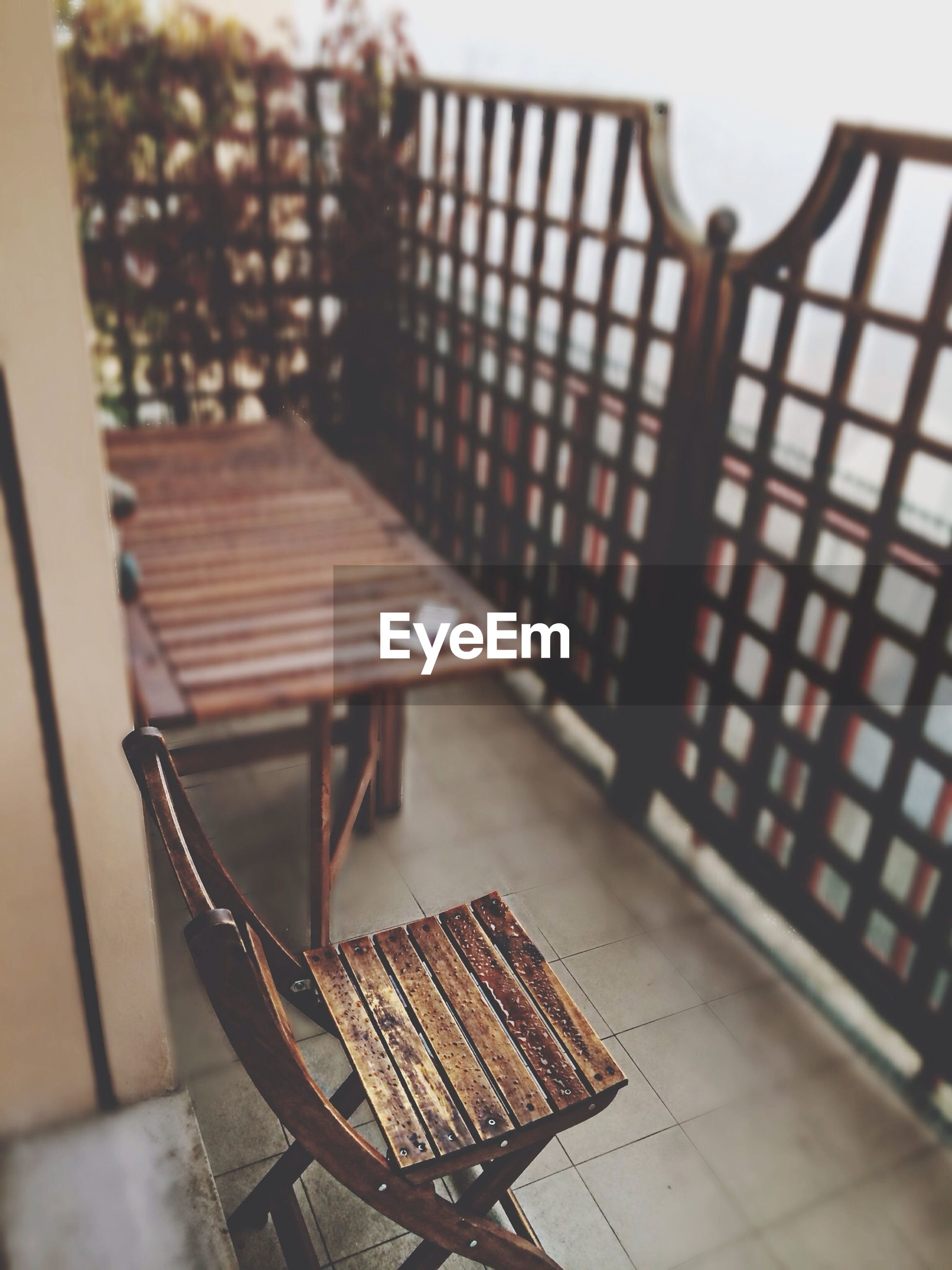 wood - material, chair, bench, railing, empty, metal, built structure, wooden, table, steps, absence, day, focus on foreground, architecture, indoors, sunlight, shadow, no people, seat, pattern