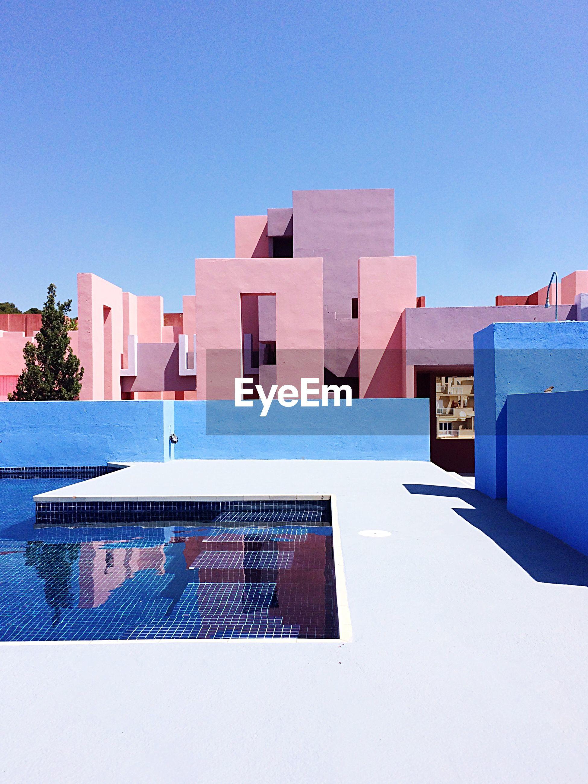HOUSES AGAINST BLUE SKY