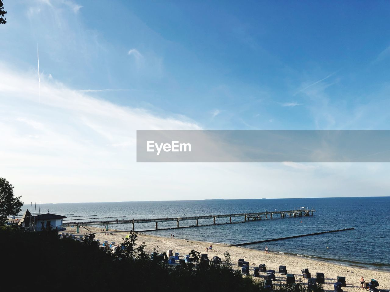 water, sky, sea, horizon, horizon over water, cloud - sky, beauty in nature, beach, group of people, scenics - nature, nature, day, land, blue, real people, large group of people, tranquility, lifestyles, tranquil scene, outdoors