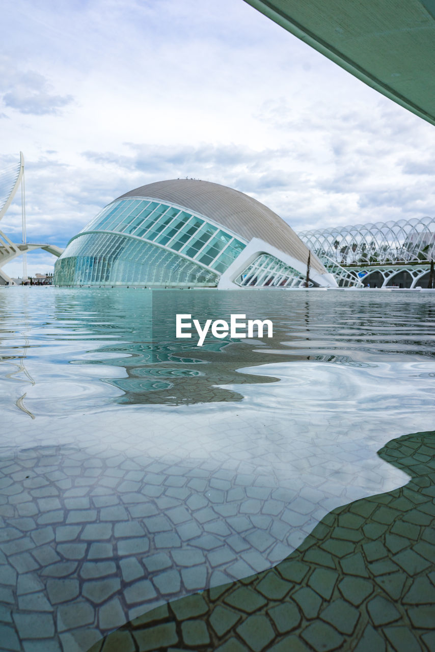 sky, cloud - sky, water, built structure, day, architecture, nature, no people, building exterior, outdoors, travel destinations, reflection, travel, waterfront, tourism, pattern, beauty in nature, swimming pool, transparent